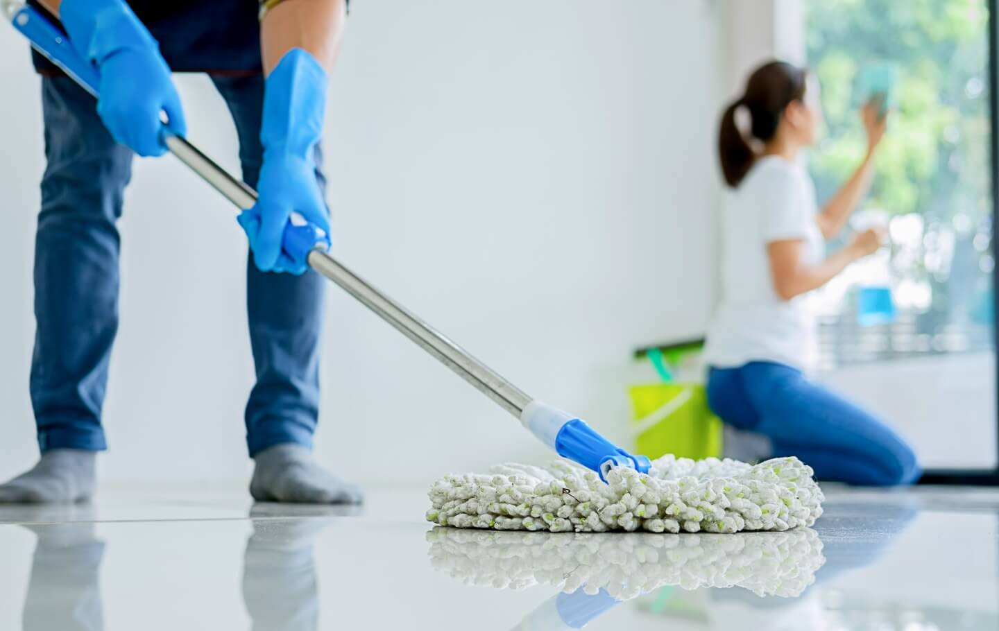 Cleaners Cleaning Floor and Window